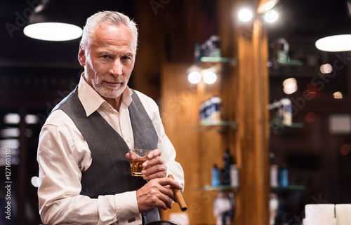 Senior gentleman with glass and cigar Poster