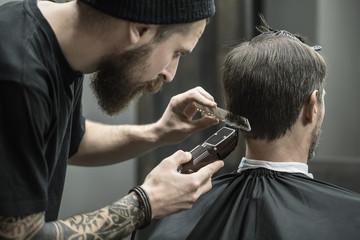 Cutting hair in barbershop