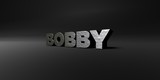 BOBBY - hammered metal finish text on black studio - 3D rendered royalty free stock photo. This image can be used for an online website banner ad or a print postcard.