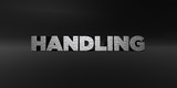 HANDLING - hammered metal finish text on black studio - 3D rendered royalty free stock photo. This image can be used for an online website banner ad or a print postcard.