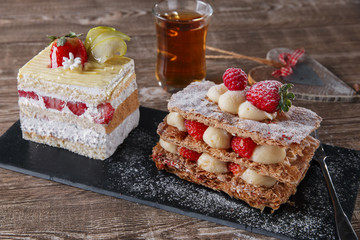 cream cake strawberry frosting mille feuille dessert sweet on black stone