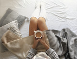 girl wakes up with morning coffee in bed