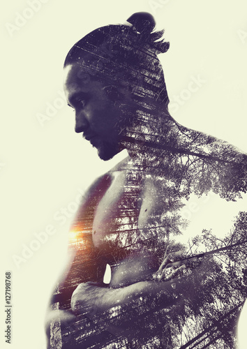 Double exposure :  muscular young man and  forest - 127198768
