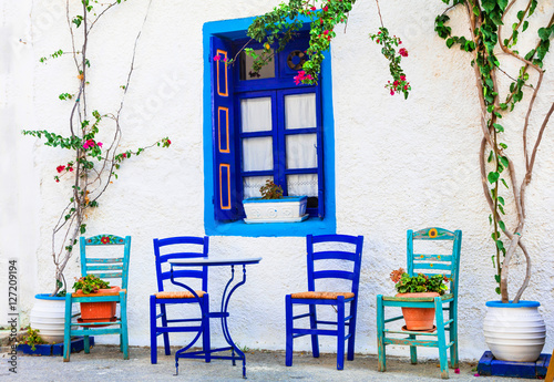Traditional Greece series - wooden chairs in small street taverna