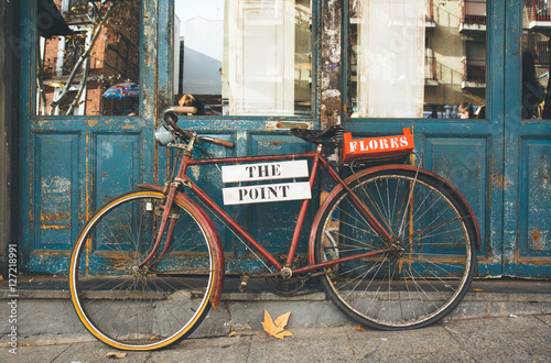 Old bicycle on old blue doors