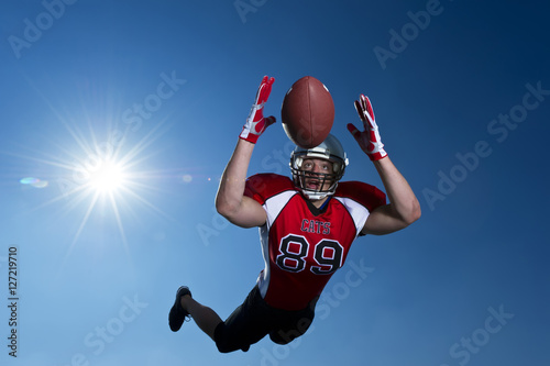 American Footballer Mid Air Dive to catch Poster