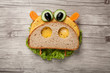 Hippo made of bread and vegetables on wooden background