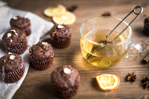Poster Chocolate cupcakes with orange and tea