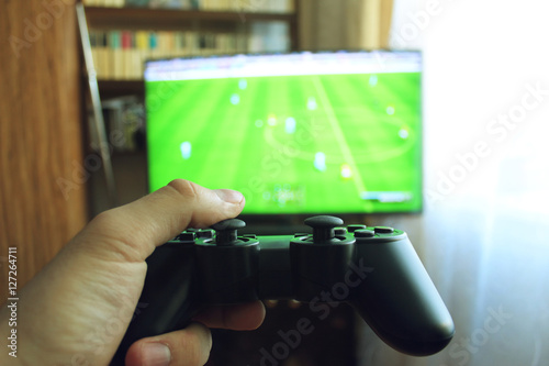 Poster Playing football with the joystick on the game console