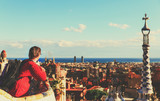 young tourist in Park Guell, Barcelona, Spain looking at panoramic view