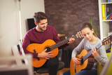 Guitar teacher teaching the little girl - 127271140