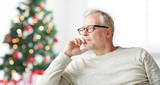 senior man in glasses thinking