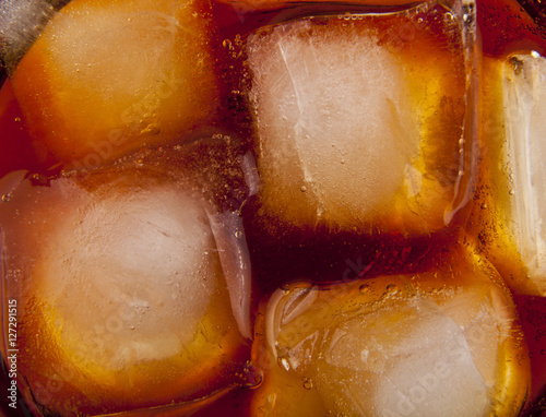 Poster cola with ice cubes