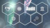 Businessman pressing a Business Audit concept