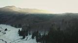 aerial view showing winter landscapes in a beautiful mountain valley
