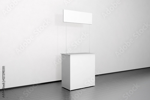 Exhibition Stall Mockup : Blank white promo counter mockup stand near the wall side view