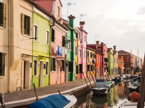 colorful street of burano island in venice, italy Poster