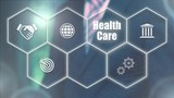 Businessman pressing a Health Care concept