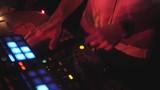 DJ hands on equipment making scratch in nightclub. Disk Jockey on open air