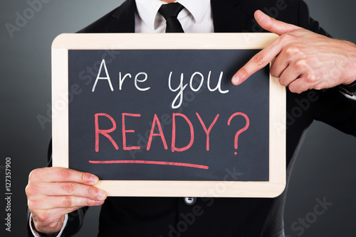 Poster Businessman Showing Are You Ready Text On Slate