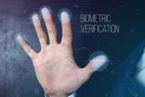 Man passing biometric identification with fingerprint scanner