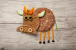 Funny bread cow made on wooden background