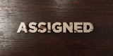 Assigned - grungy wooden headline on Maple  - 3D rendered royalty free stock image. This image can be used for an online website banner ad or a print postcard.