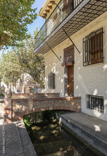 Poster Waterway Typical street of the village and entrance to a house Anna Valencia Spa