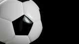 Soccer ball or football bright studio on a black background. video rotation