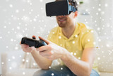 close up of man in virtual reality headset playing