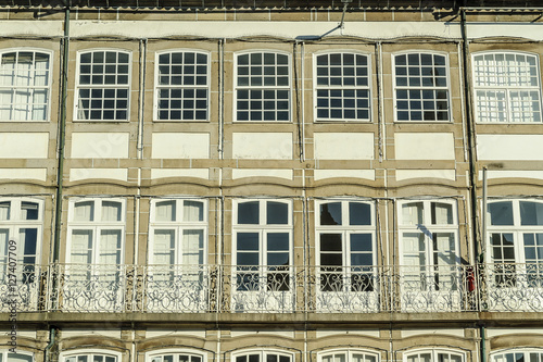 traditional large windows of a building in the square of the Toural of Guimaraes's town, Portugal - 127407709