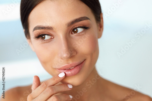 Beauty Face. Beautiful Woman Touching Lips With Lip Balm On Poster