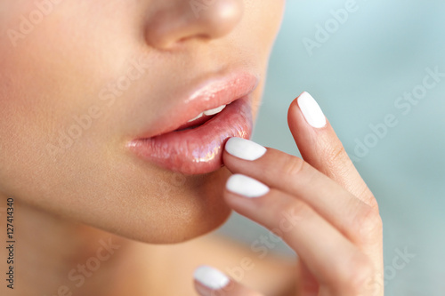 Lips Protection. Closeup of Healthy Woman Lips And Smooth Skin Plakat