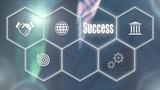 Businessman pressing a Business Success concept