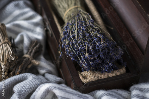Poster opened wooden box with lavender on woolen shawl