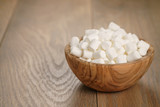 white marshmallows in wooden bowl on table
