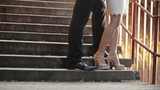 Couple Standing on Stairs