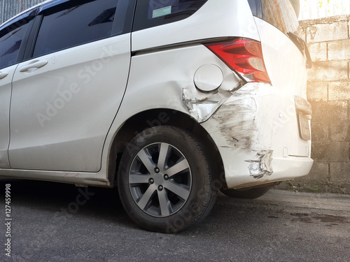 Details of a white car in an accident, Car crash, insurance, soft focus, light effect Poster