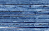 Weathered blue color log house wall. - 127470114