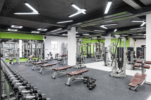 gym with exercise equipment and a black ceiling