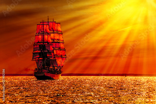 Poster Baksteen Sailing ship on the sea at sunset skyline.