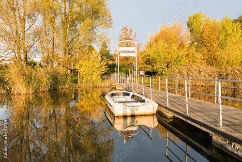 Plexiglas Pier Boarding pier for Virginia island, lake Varese, Biandronno, Italy, in a beautiful sunny autumn day