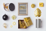 Christmas decorations, ornaments and objects in black and gold for mock up template design.View from above. Flat lay