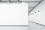 Art gallery with large white wall and pictures