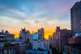Sunset over a New York City neighborhood.