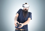 Man in vr glasses near a gray wall
