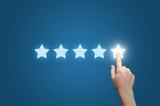 Businesswoman pointing five star to increase - 127512395