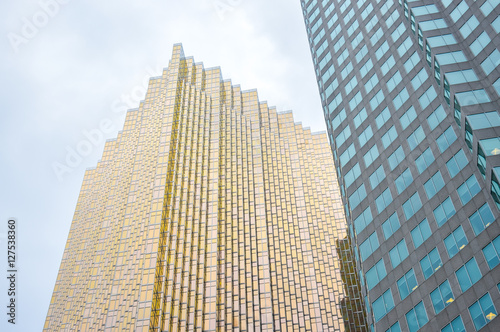 Poster Facade of gold and brown  glass skyscrapers in Toronto downtown at low angle