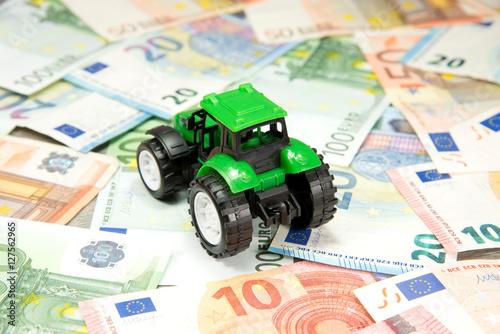Poster Ein Traktor und Bargeld