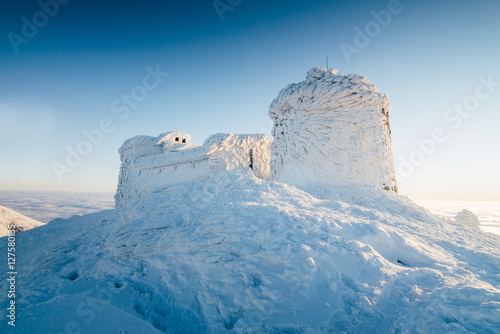 Poster Frozen old observatory building on top of Carpathian mountains